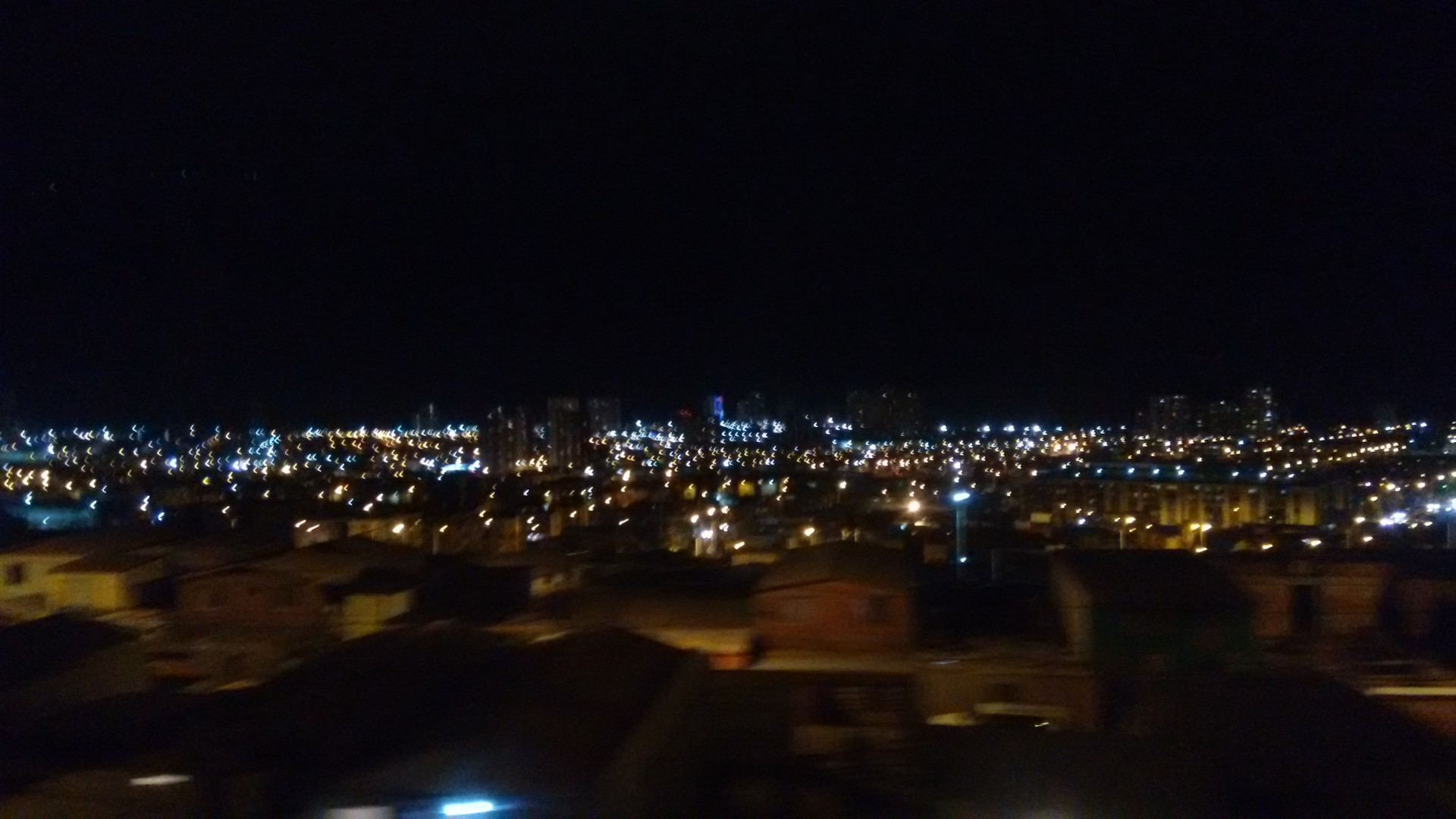 Iquique at night. Through a bus window.